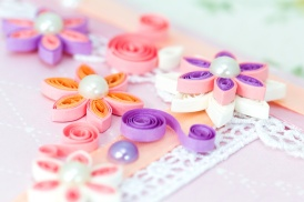 Closeup of pink quilling paper flowers based on postcard
